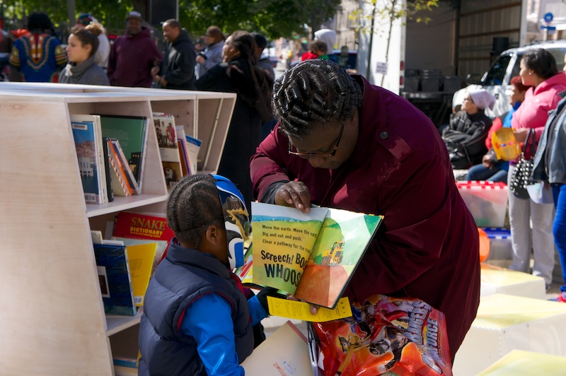 Reading together in public on Pitkin Plaza, Brooklyn