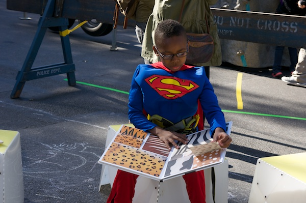 Superman kept coming back. Read books between dominating turns on the climbing wall.