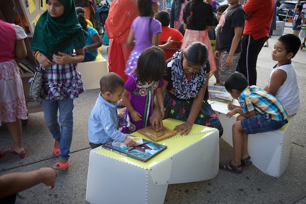 The Uni portable reading room. Ozone Park Plaza. 2014.
